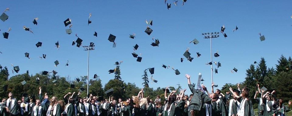 Graduates throwing their caps