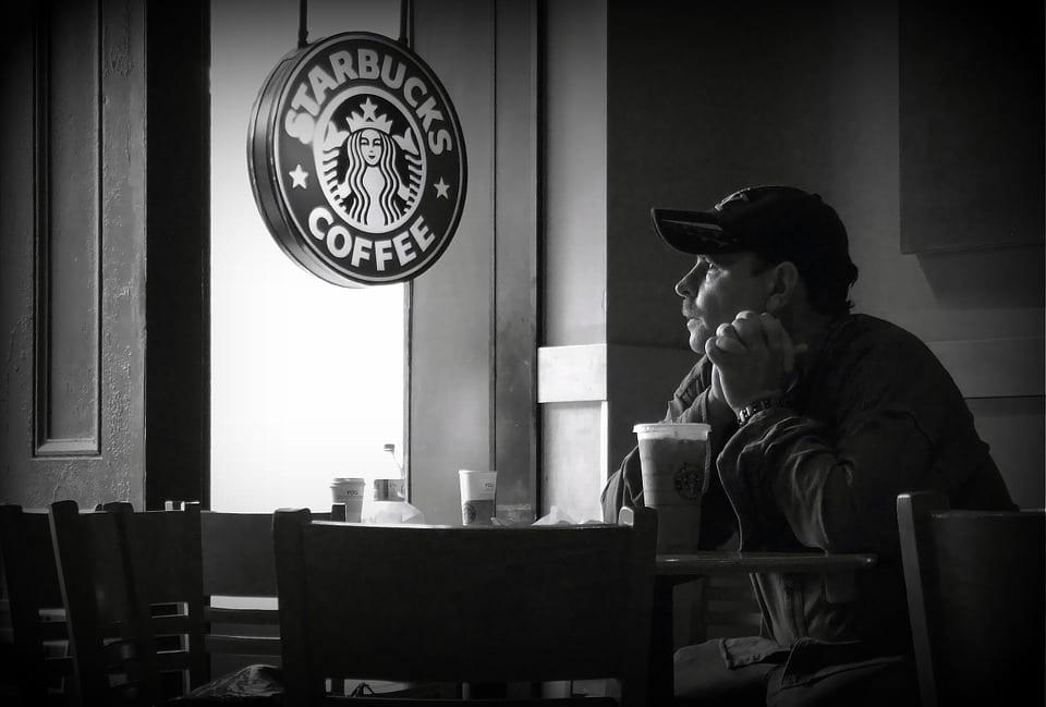 Man sitting in a Starbucks coffee shop