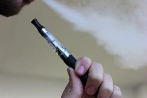 Person holding an e-cigarette