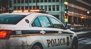 Side view of parked police car; image by Matt Popovich, via Unsplash.com.