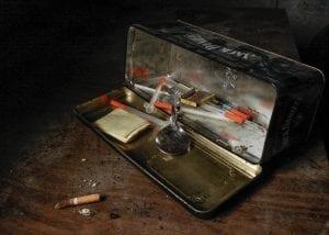 Syringes and spoon in metal storage box; image by Matthew T. Rader, via Unsplash.com.