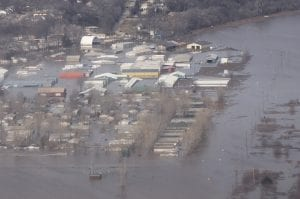 Aerial photo of an Air Force base and surrounding area swallowed by flooding.