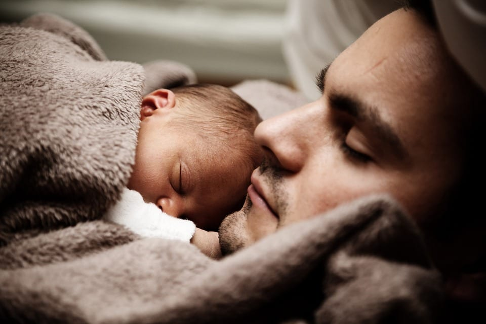 Father holding a child