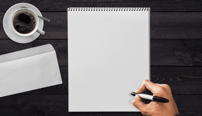 Man putting pen to a blank sheet of paper with envelope and cup of coffee nearby; image by www_darkworkx_de, via Pixabay.com.