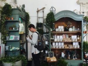 Man browsing in shop; image by Ellen Auer, via Unsplash.com.