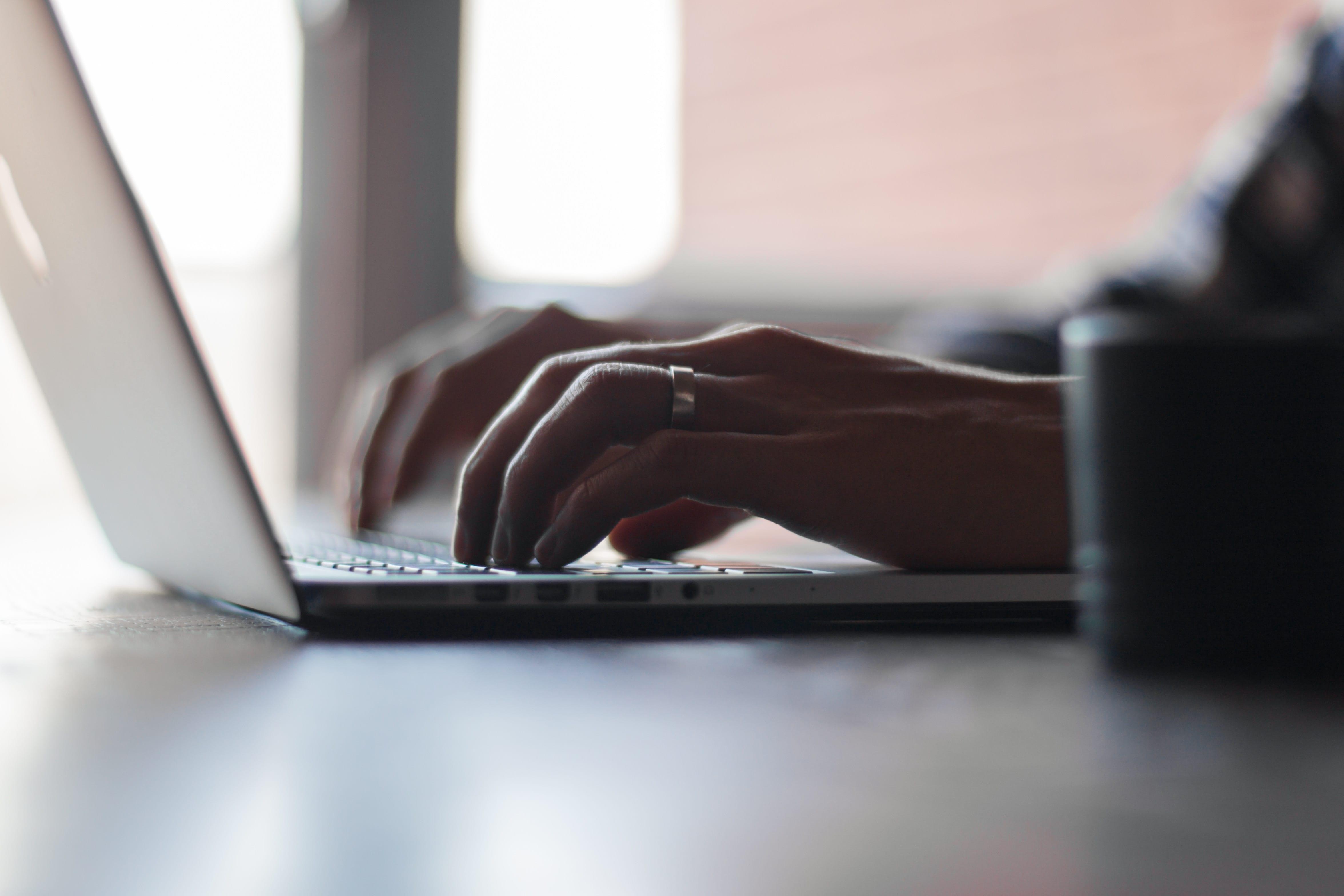 Man using laptop; photo by Thomas Lefebvre on Unsplash.