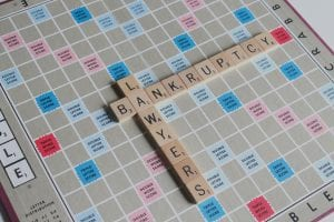 """Scrabble board with tiles spelling out """"Bankruptcy Attorney;"""" image by Melinda Gimpel, via Unsplash.com."""