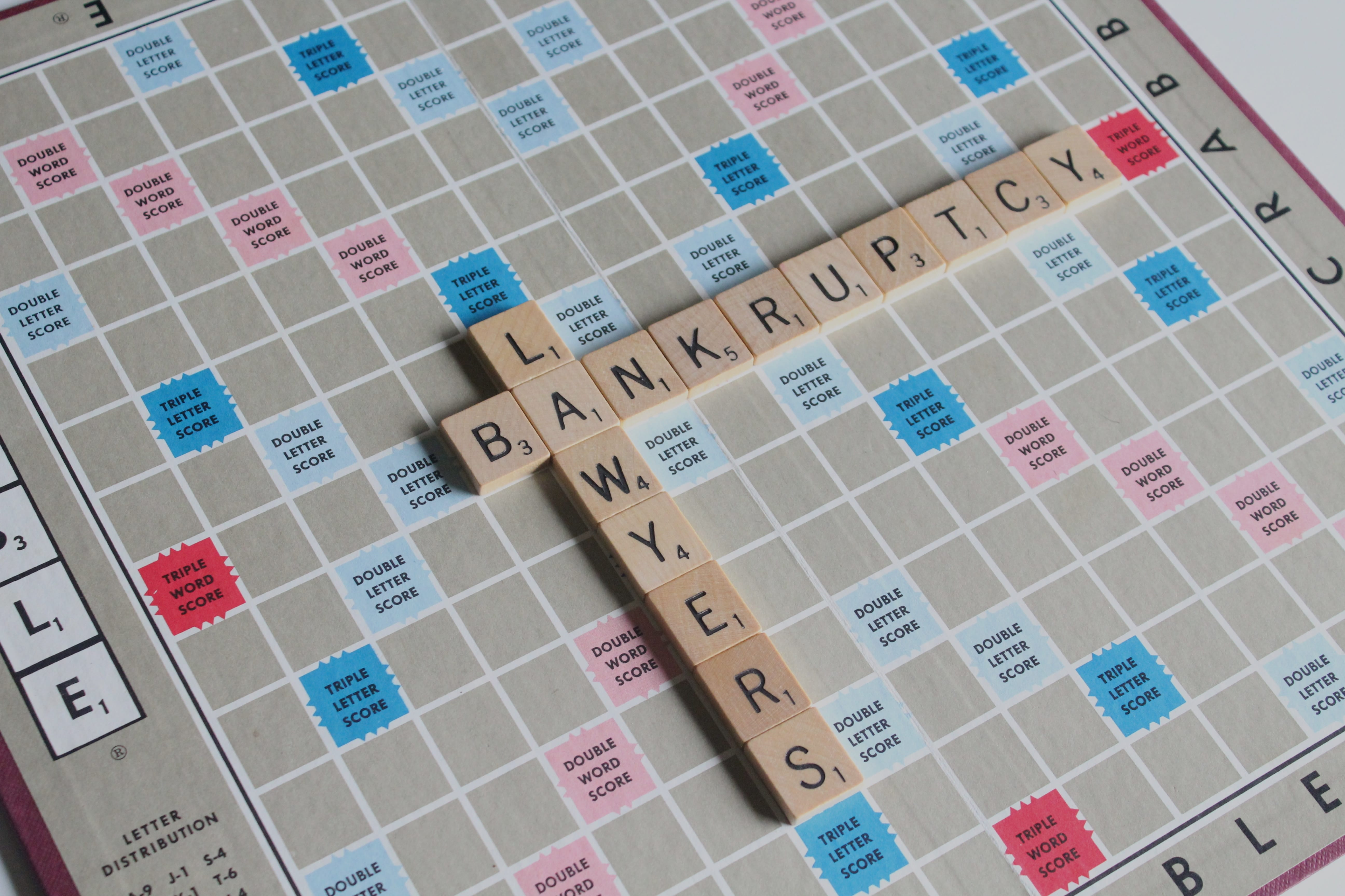 "Scrabble board with tiles spelling out ""Bankruptcy Lawyers;"" image by Melinda Gimpel, via Unsplash.com."