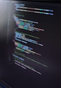 Lines of computer code on a monitor; image by Oscar Nord, via Unsplash.com.
