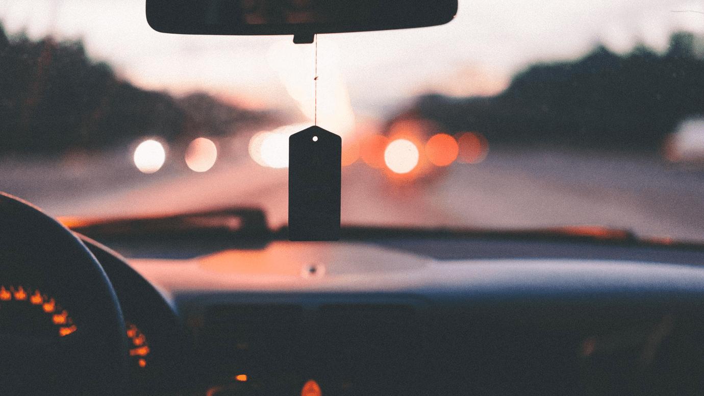 Car dashboard at night; image by A.L., via Unsplash.com.