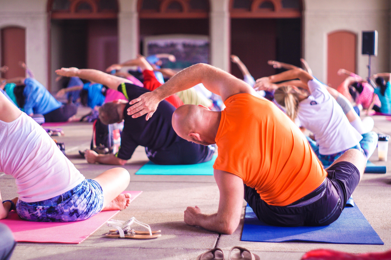 Group yoga session; image by Anupam Mahapatra, via Unsplash.com.
