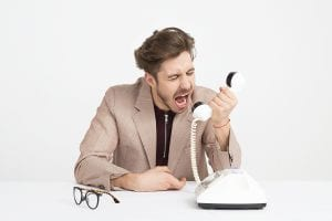 Man screaming into telephone; image by Icons8 Team, via Unsplash.com.