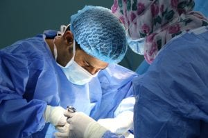 Doctor performing surgery; image by Jafar Ahmed, via Unsplash.com.