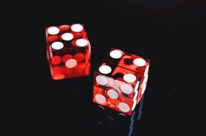 Two red die with white dots; image by Jonathan Peterson, via Unsplash.com.