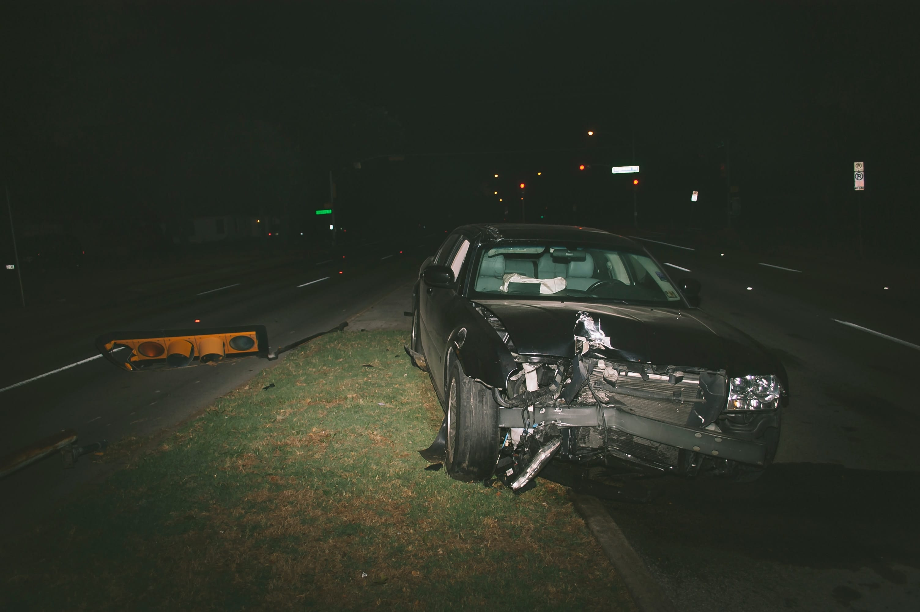 Car accident at night showing vehicle with front-end damage; image by Matthew T. Rader, via Unsplash.com.