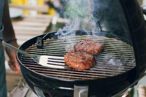 Burgers on the grill; image by Maude Frédérique Lavoie, via Unsplash.com.