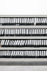 Shelf full of binders; image by Samuel Zeller, via Unsplash.com.