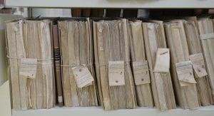 Large binders of files; image by Manu Schwenderer, via Unsplash.com.