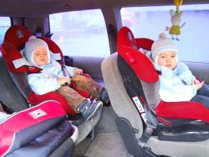 Children sitting in car seats