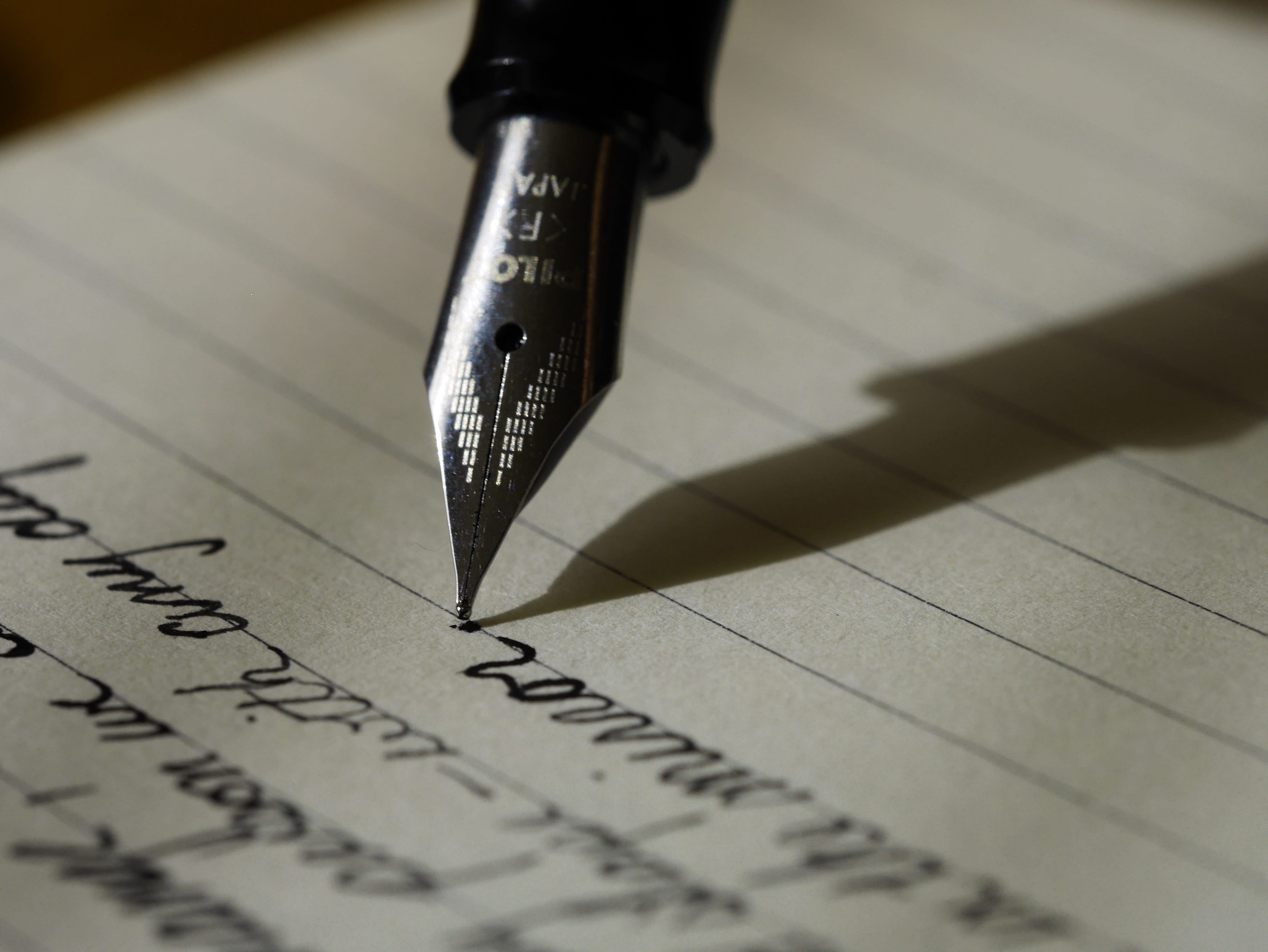 Writing with a fountain pen; image by Aaron Burden, via Unsplash.com.