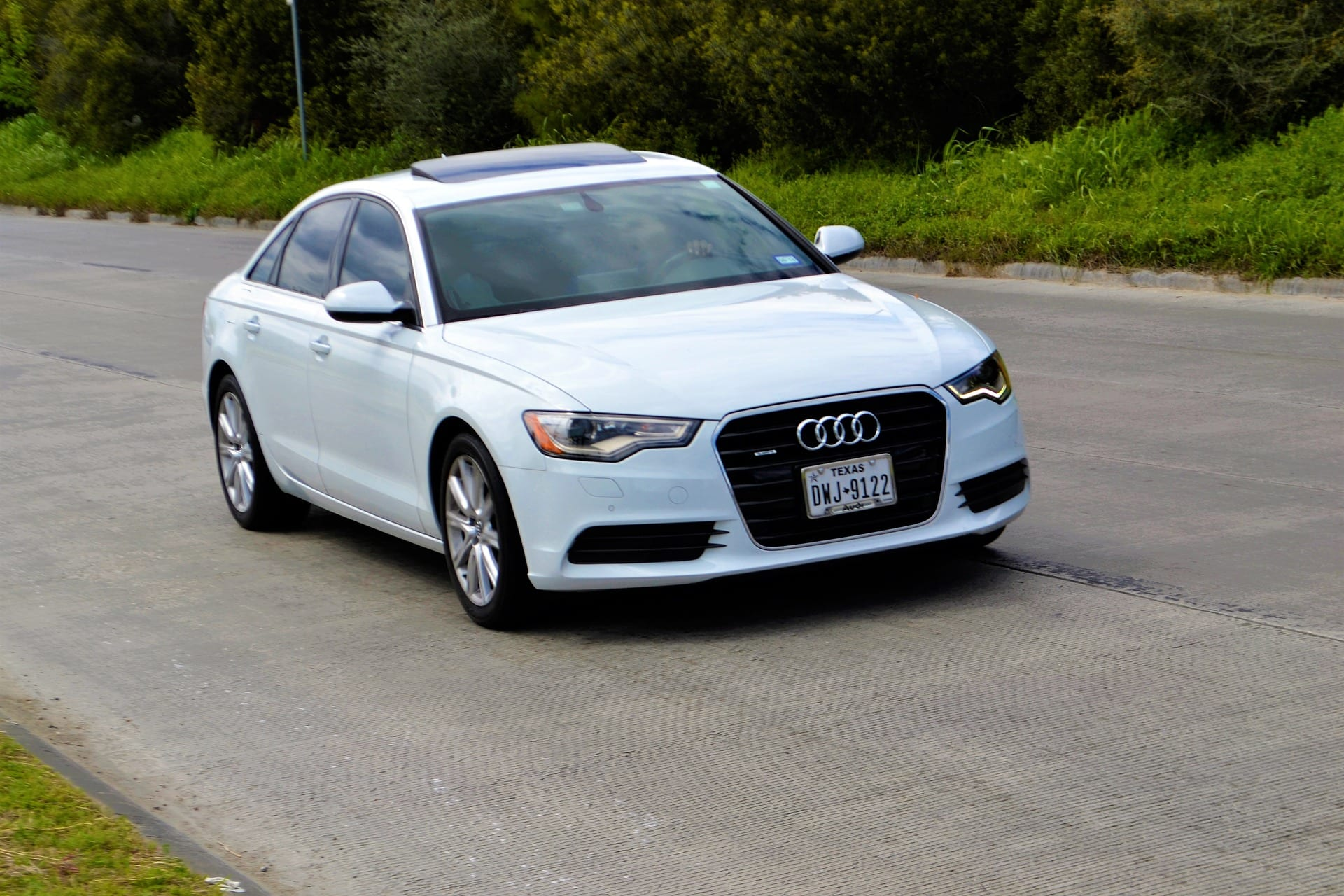 White Audi A6 sedan; image by ArtisticImpressions, via Pixabay.com.