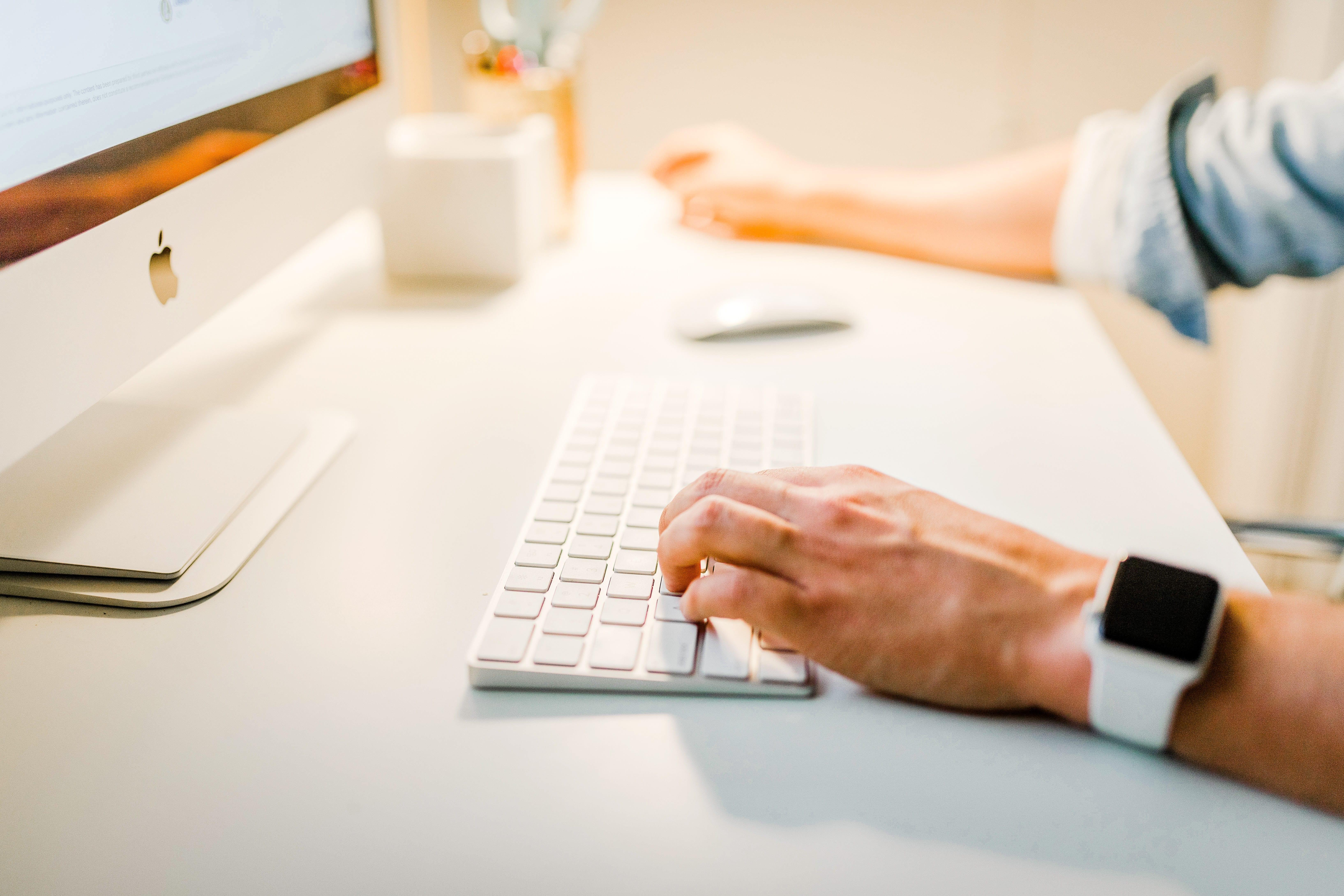 Man working at computer; image by Austin Distel, via Unsplash.com.