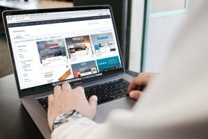 Man designing website on a laptop; image by Campaign Creators, via Unsplash.com.