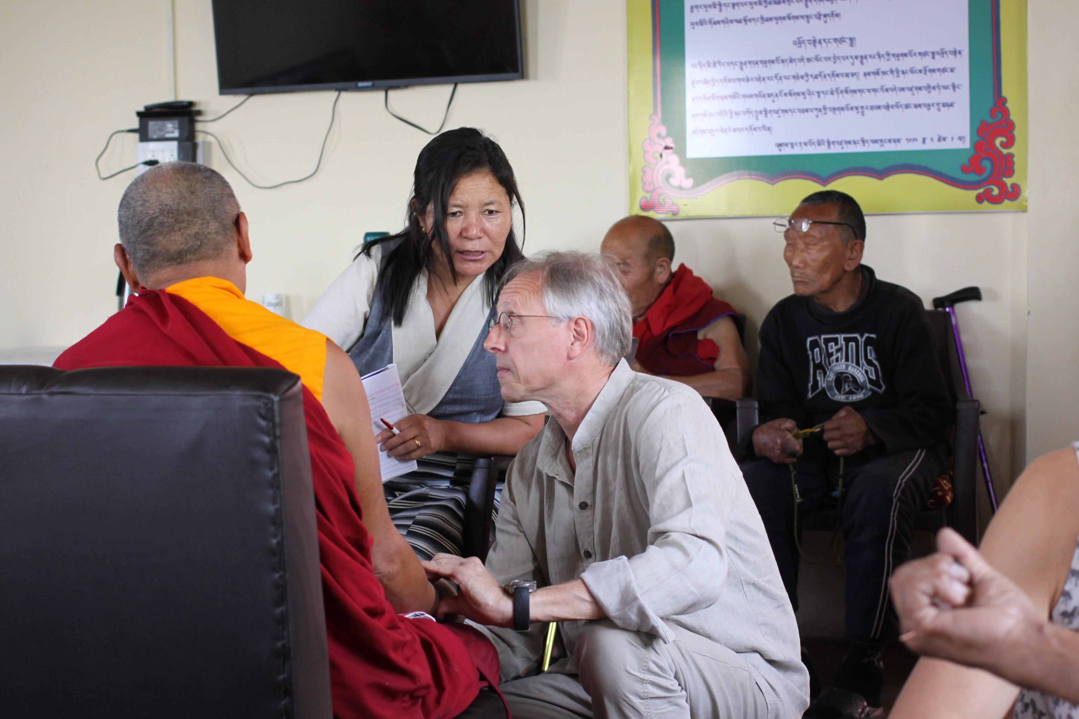 Buddhist monk being seen by doctor; image by Delfynn Aldag, via Unsplash.com.
