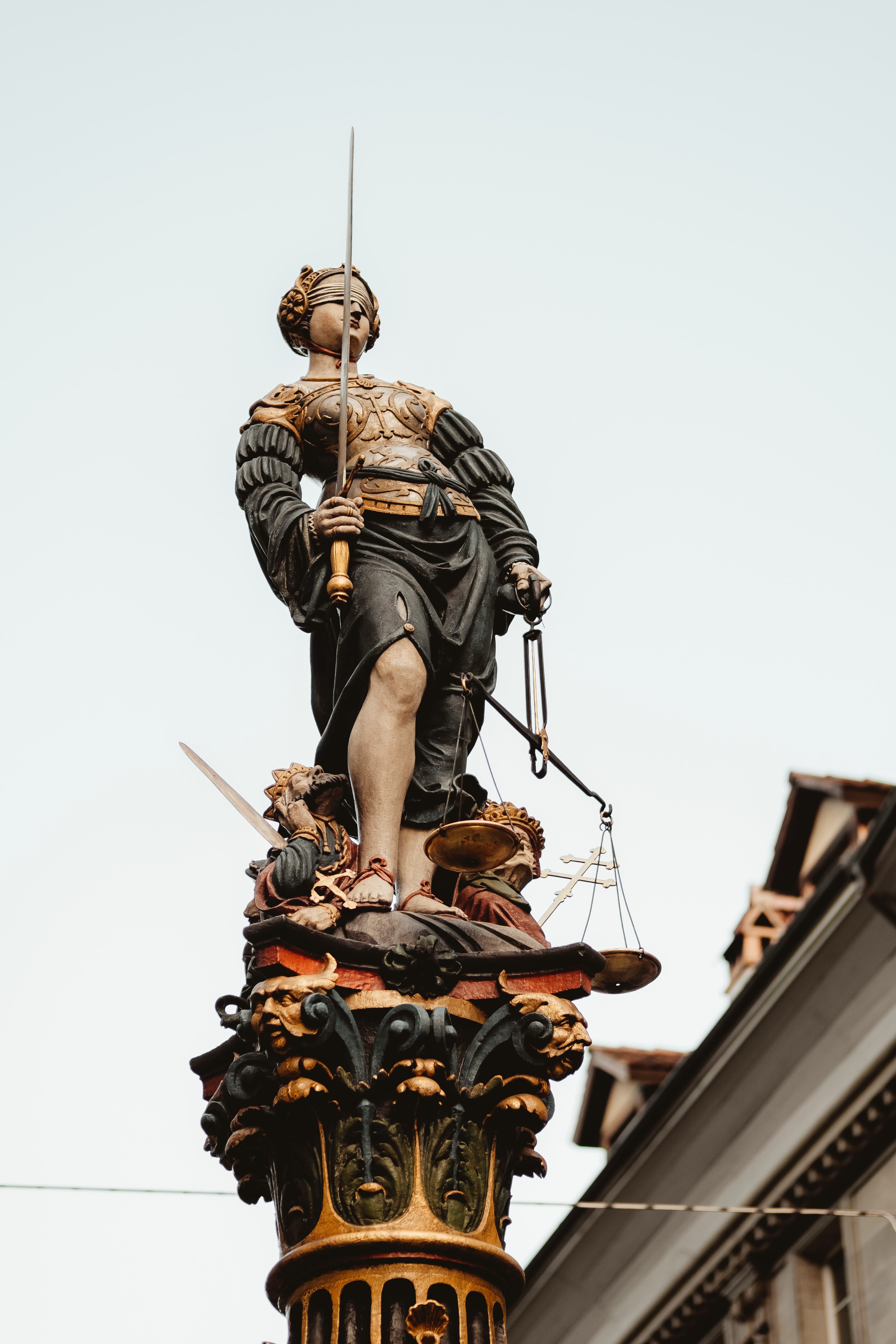 Statue of Lady Justice; image by Joel & Jasmin Førestbird, via Unsplash.com.