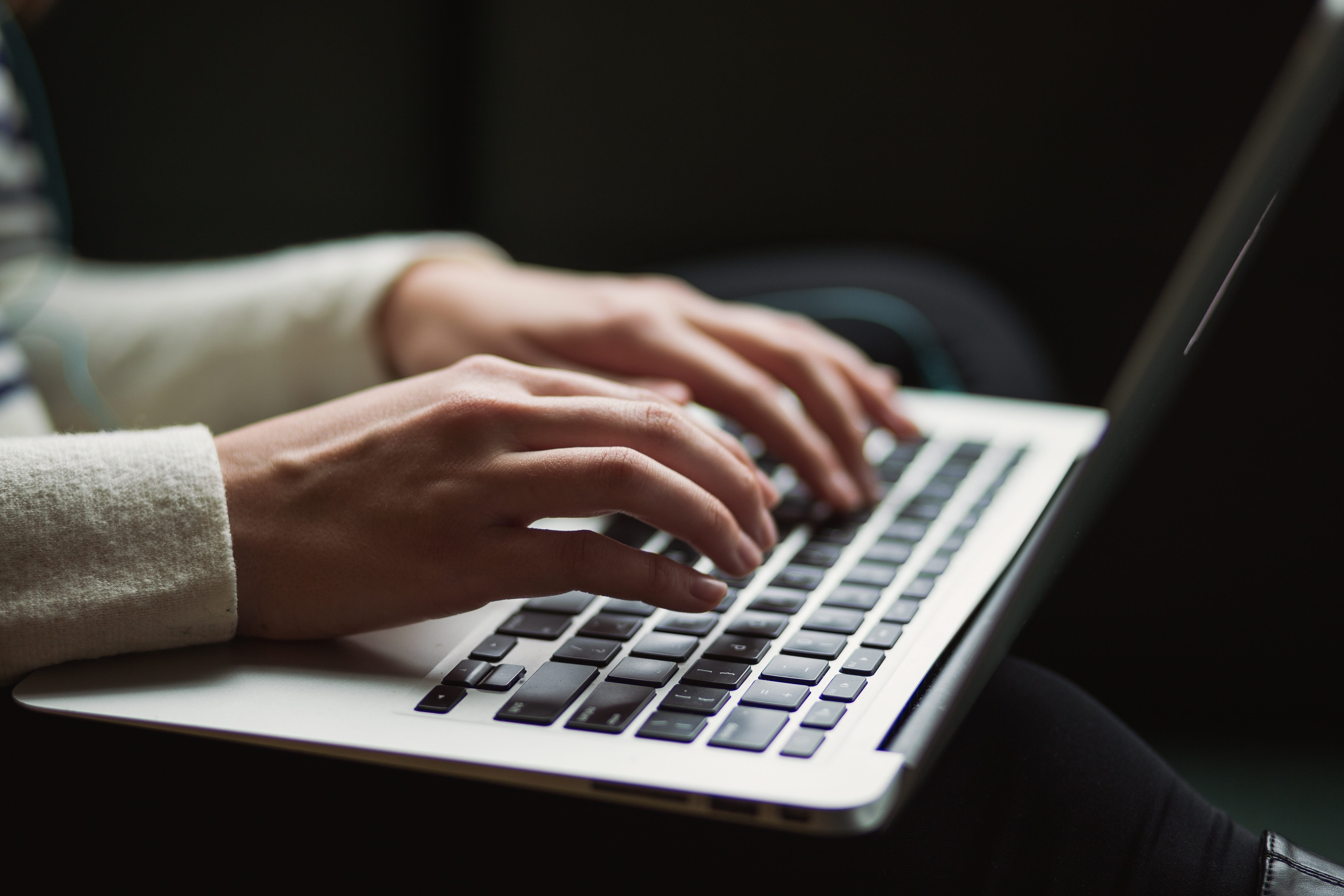 Person using laptop; image by Kaitlyn Baker, via Unsplash.com.