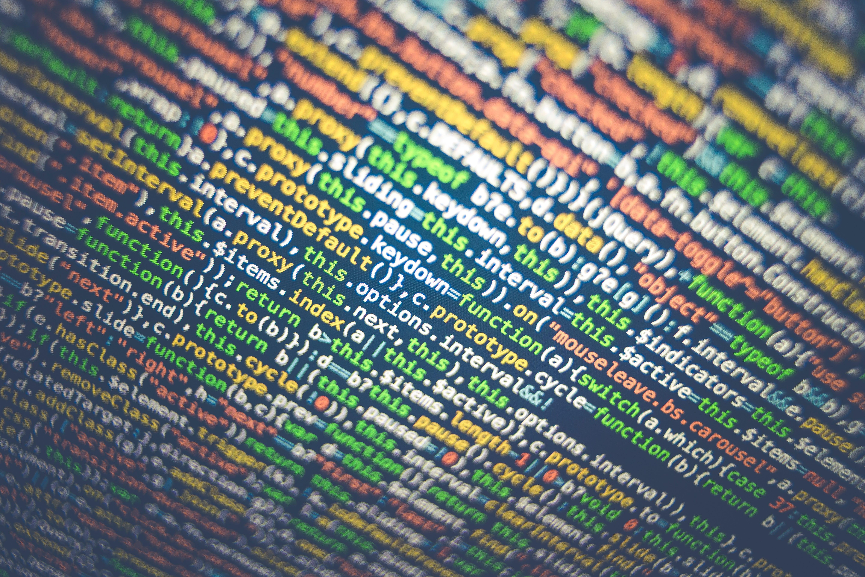 Tilt-shift photography of HTML codes; image by Markus Spiske, via Unsplash.com.