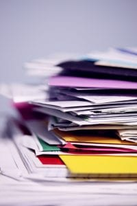 Pile of mail waiting to be sorted; image by Sharon McCutcheon, via Unsplash.com.