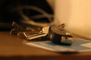 Selective focus shot of car keys sitting on table; image by LauraTara, via Pixabay.com.