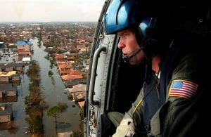 A U.S. Coast Guardsman searches for survivors in New Orleans in the Katrina aftermath