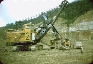 A giant earthmoving machine rests in a barren copper mine that once was home to natives of Bougainville.