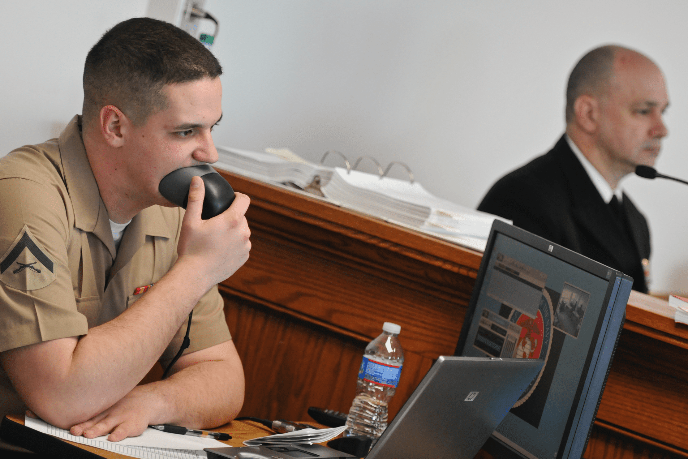 Lance Cpl. Matt Williamson, the court reporter, records testimony during a mock trial at the Naval Justice School (NJS). The mock trial is the final graded event for students at the NJS. U.S. Navy photo by Mass Communication Specialist 2nd Class Eric Dietrich/Released. U.S. Naval War College, CC BY 2.0, no changes.