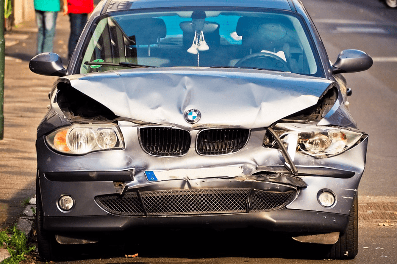 Silver BMW with front end smashed in; image by Michael Gaida, via Pixabay.com.