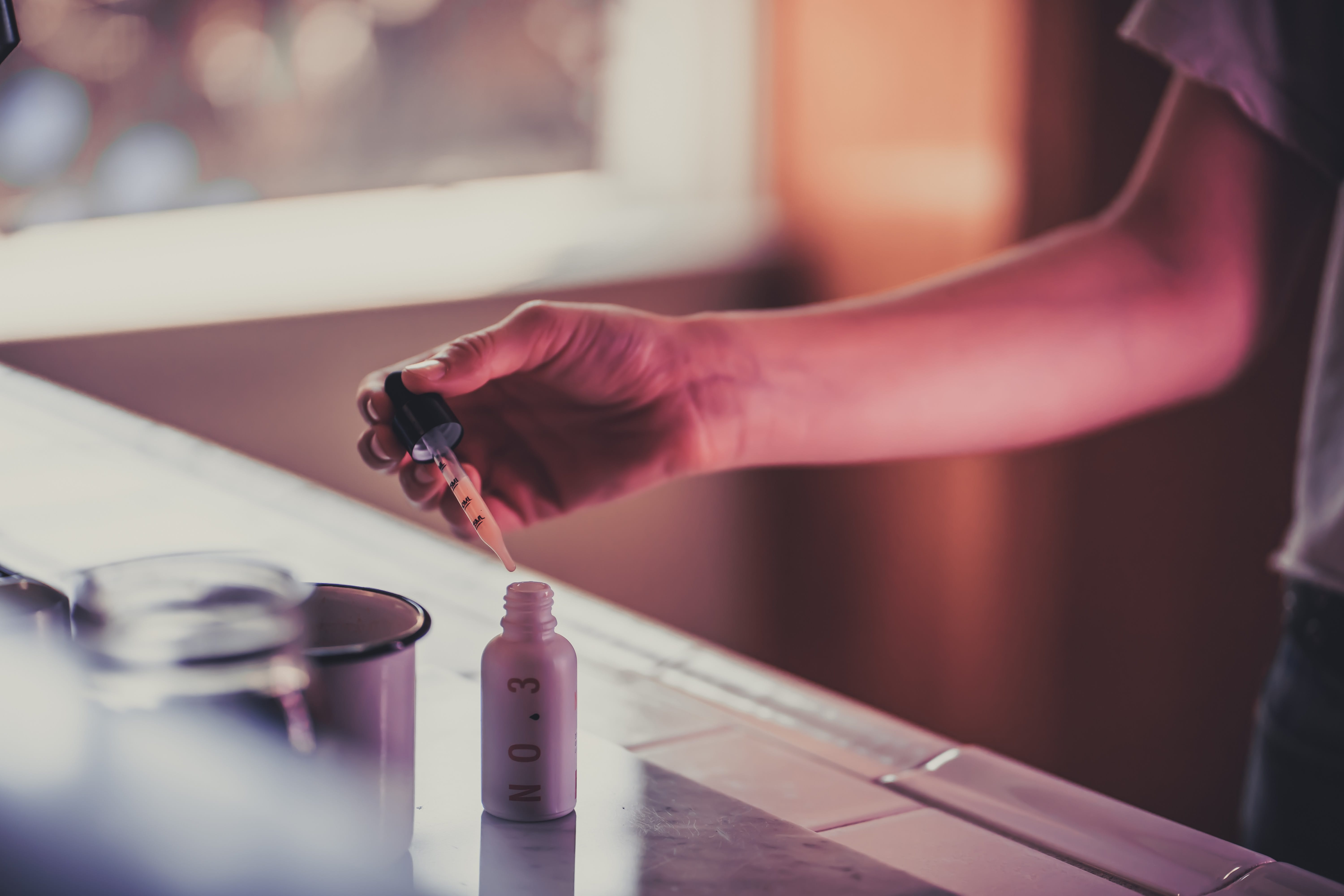 Woman taking few drops of a water-soluble CBD from Eir Health; image by Michal Wozniak, via Unsplash.com.