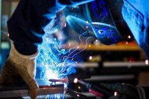Man welding; image by Rob Lampert, via Unsplash.com.