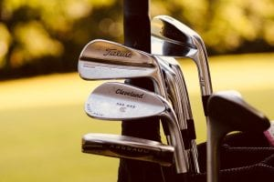 Gray steel golf clubs on selective focus photo; image by Sydney Rae, via Unsplash.com.