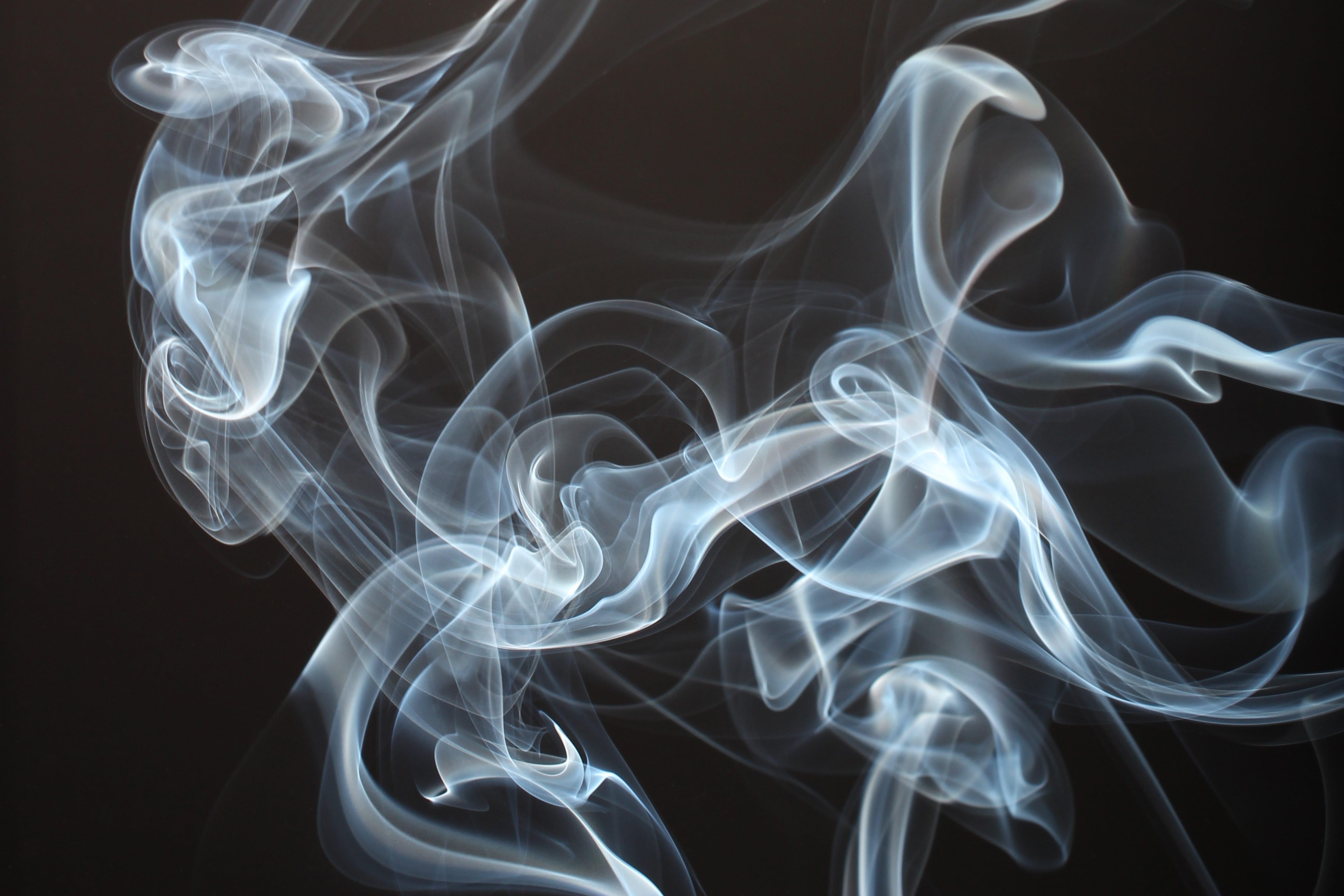 Smoke against a black background; image by Thomas Stephan, via Unsplash.com.