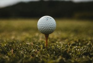 Golf ball on tee; image by Will Porada, via Unsplash.com.