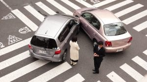 Two cars in an accident in an intersection; image by Shuets Udono, via Flickr, CC BY-SA 2.0, no changes.