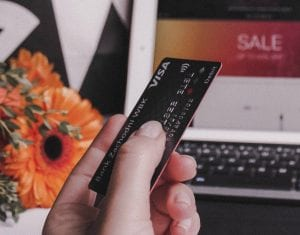 Person holding Visa credit card; image by Anastasiia Ostapovych, via Unsplash.com.