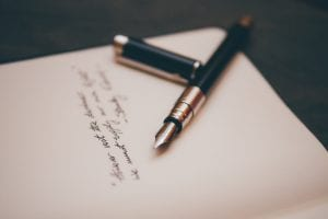 Black and silver fountain pen on paper; image by Álvaro Serrano, via Unsplash.com.