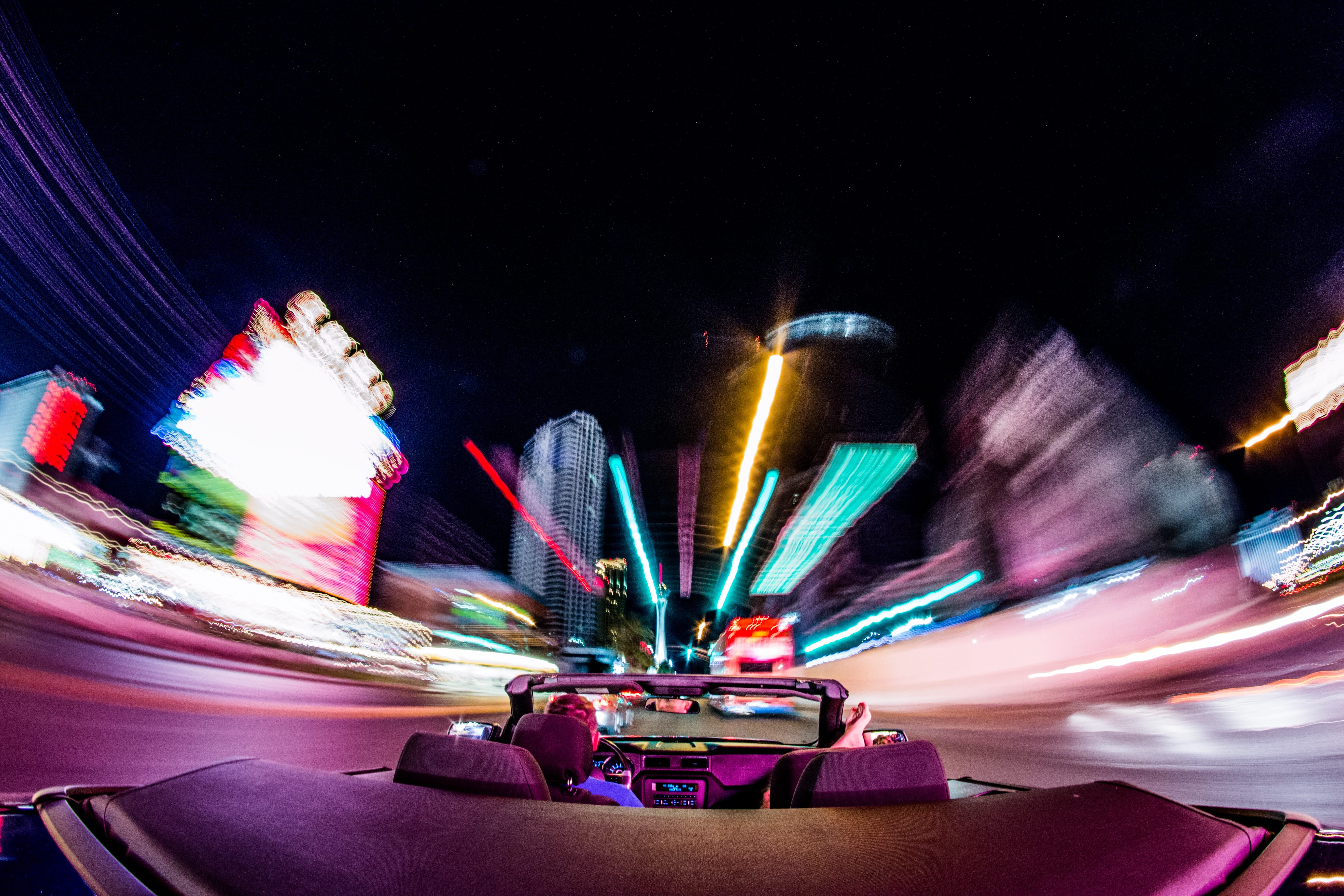 Timelapse photograph of driving in Las Vegas at night; image by Jakub Gorajek, via Unsplash.com.