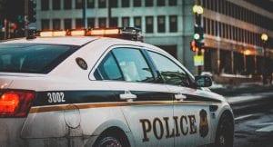 Police car on street; image by Matt Popovich, via Unsplash.com.