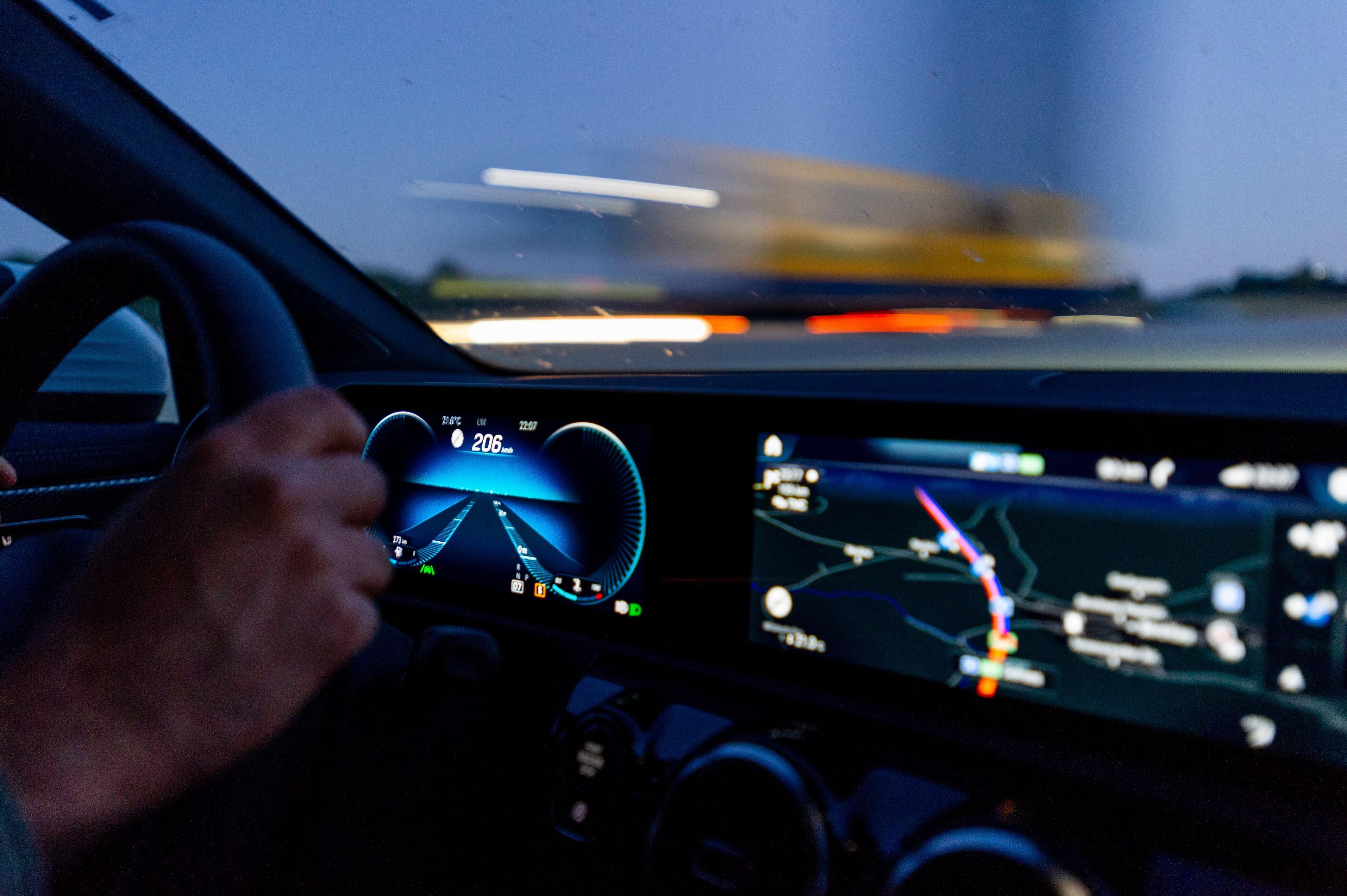 Man's hand on steering wheel; image by Randy Tarampi, via Unsplash.com.