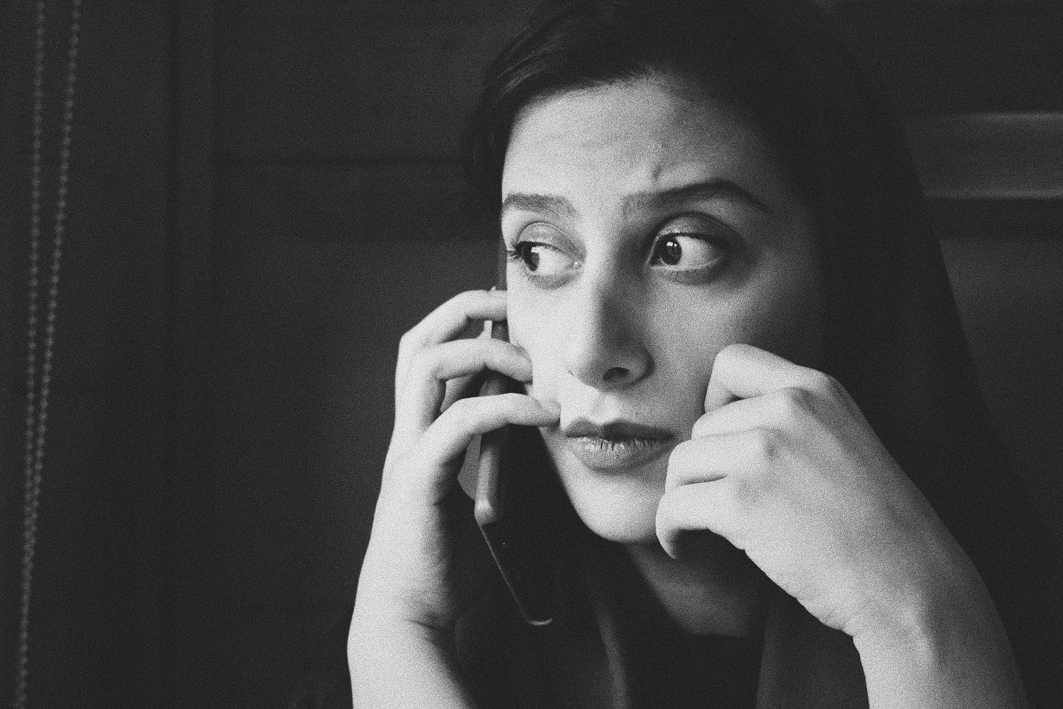 Greyscale photo of woman on a phone call; image by Siavash Ghanbari, via Unsplash.com.