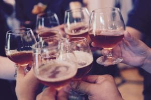 Group of people toasting with snifters; image by Yutacar, via Unsplash.com.